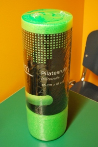 You can buy foam rollers from Prisma. It was called a Pilates roll and cost me 9,95€. The longer version cost 19,95€.